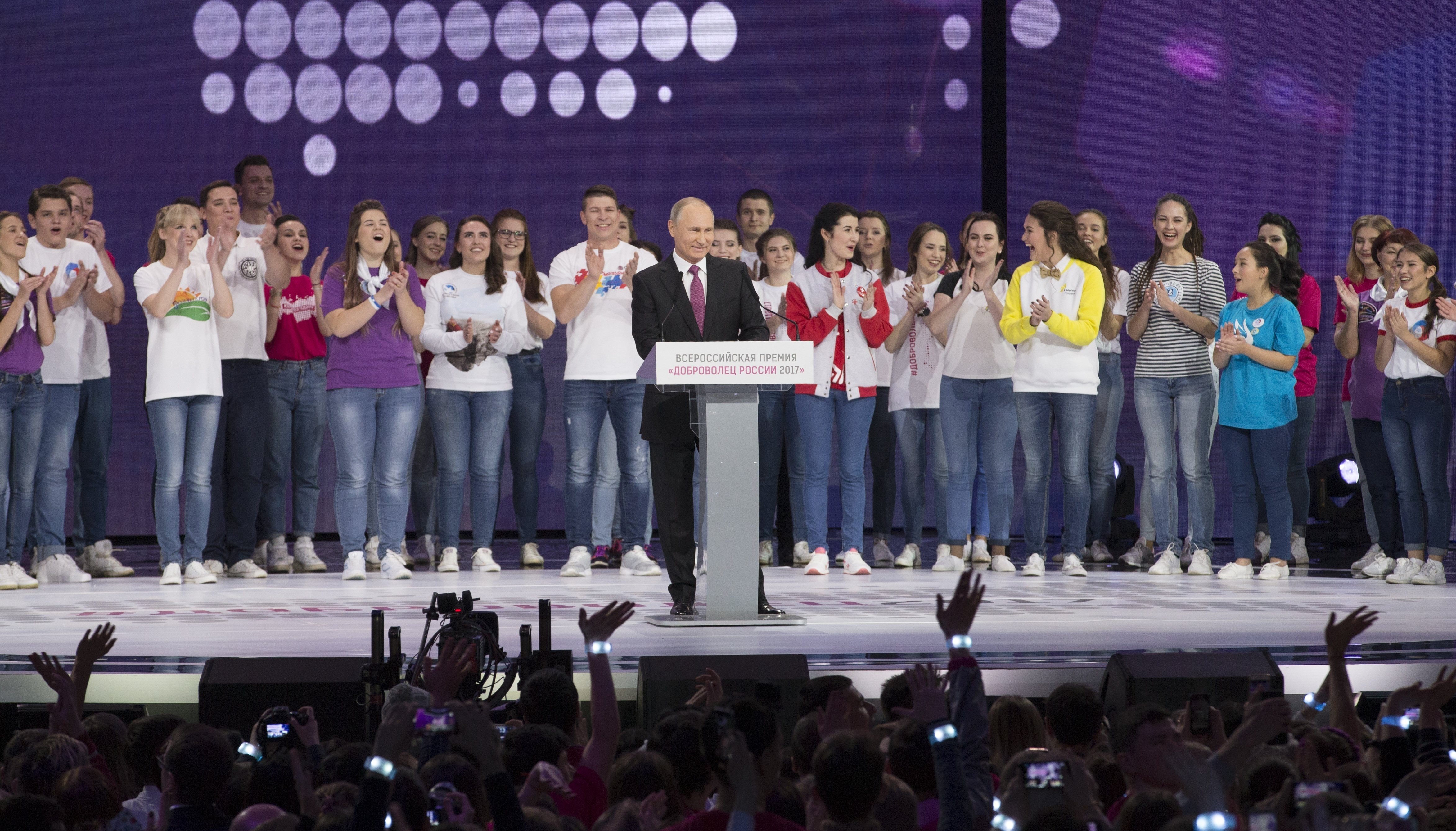 Russian President Vladimir Putin, center, arrives to attend at the annual Volunteer of Russia 2017 award ceremony at the Megasport Sport Palace in Moscow, Russia, Wednesday, Dec. 6, 2017. Putin has moved an inch closer to announcing his intention to seek re-election in the next March's vote, saying he would weigh the move based on public support. (AP Photo/Ivan Sekretarev)
