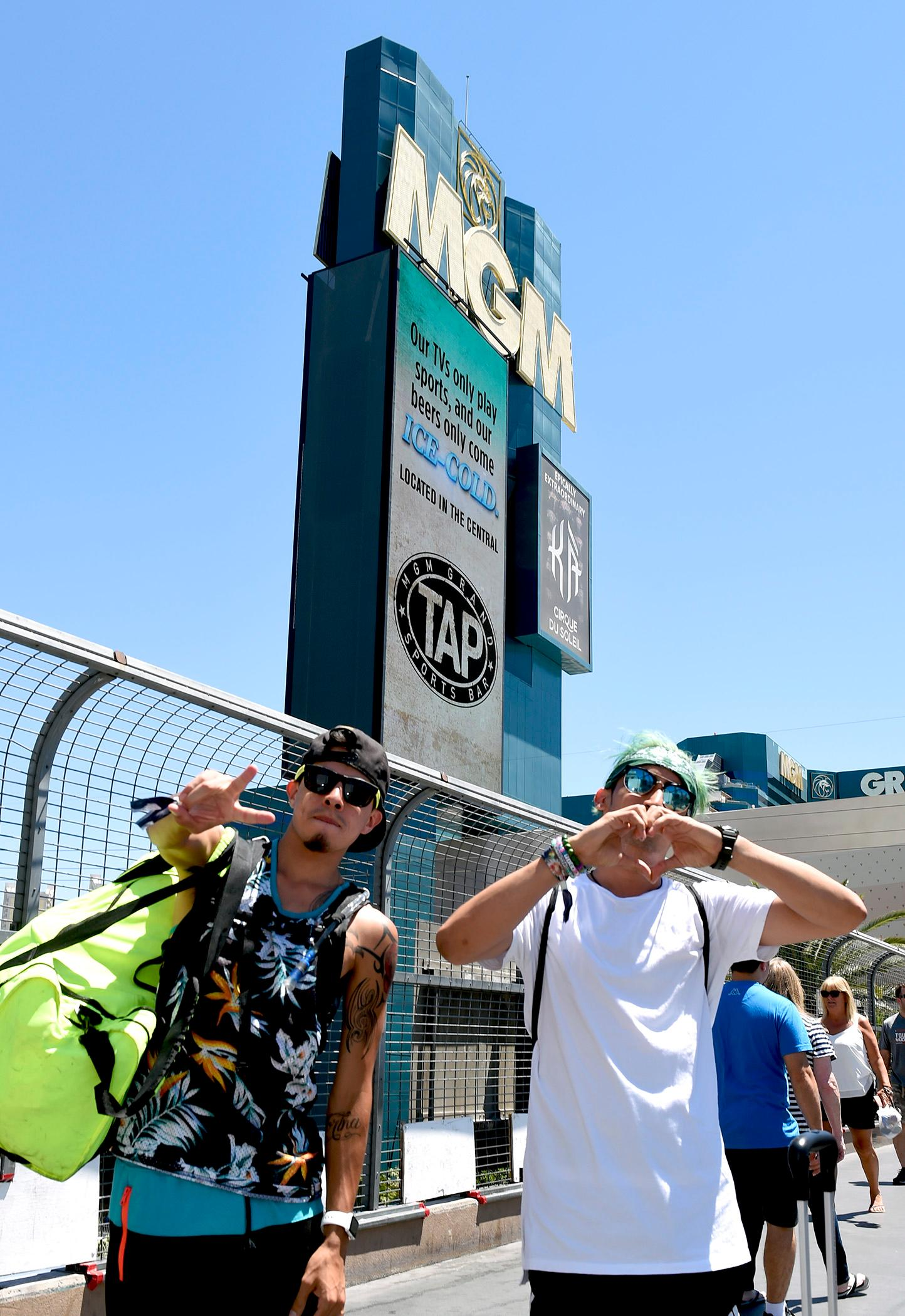 Electric Daisy Carnival fans turn into typical Las Vegas tourists...well for the most part... with a couple of hours sleep after Day 2 of the EDC event at the  Las Vegas Motor Speedway. Sunday, June 18, 2017. [Glenn Pinkerton/Las Vegas News Bureau]