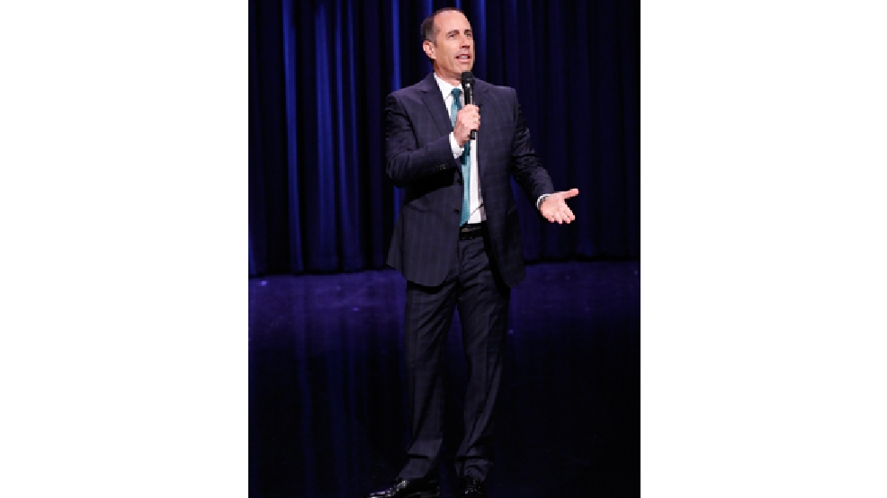 "This Tuesday, Feb. 18, 2014 photo released by NBC shows comedian Jerry Seinfeld performing during ""The Tonight Show Starring Jimmy Fallon,"" in New York. (AP Photo/NBC, Lloyd Bishop)"