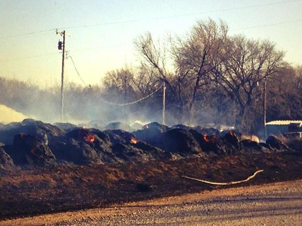 Smoldering hay bales in Logan County.