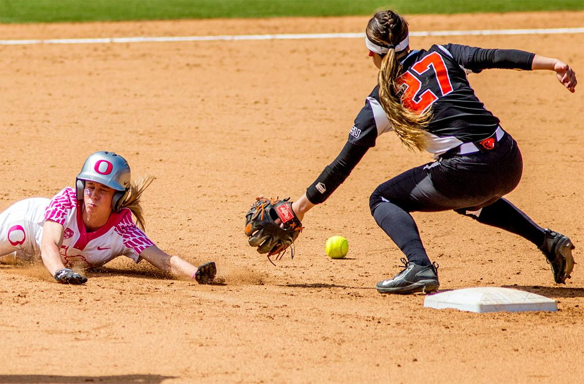 The Duck's Alexis Mack (#10) slides into second base. The Oregon Ducks defeated the Oregon State Beavers 7-2 in game two of the three-game Civil War series at Jane Sanders Stadium on Saturday. The final game of the series will be on Sunday at 3:00 p.m. at Jane Sanders Stadium. Photo by August Frank, Oregon News Lab