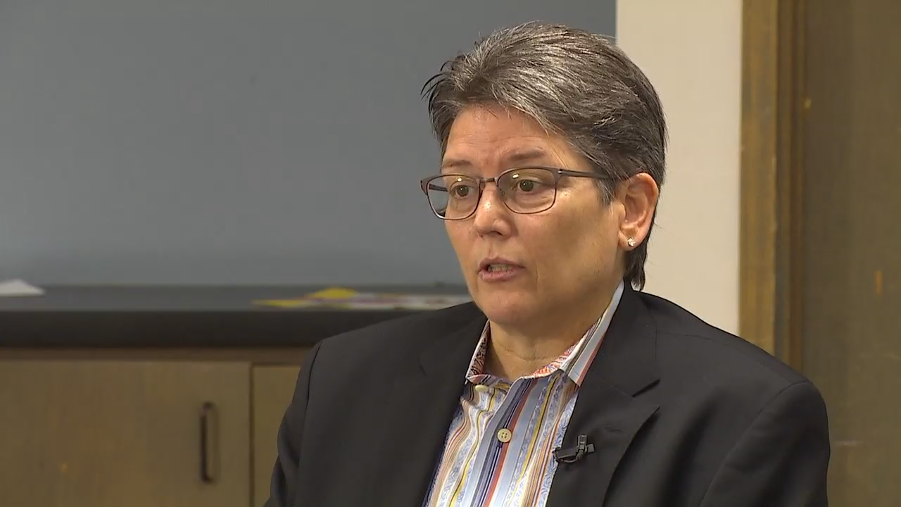 Lugging her case of berry-flavored sparkling water and her briefcase, Mitzi Johanknecht walked into the King County Sheriff's Office Burien precinct ready for another day of leading a double life Tuesday. (Photo: KOMO News)