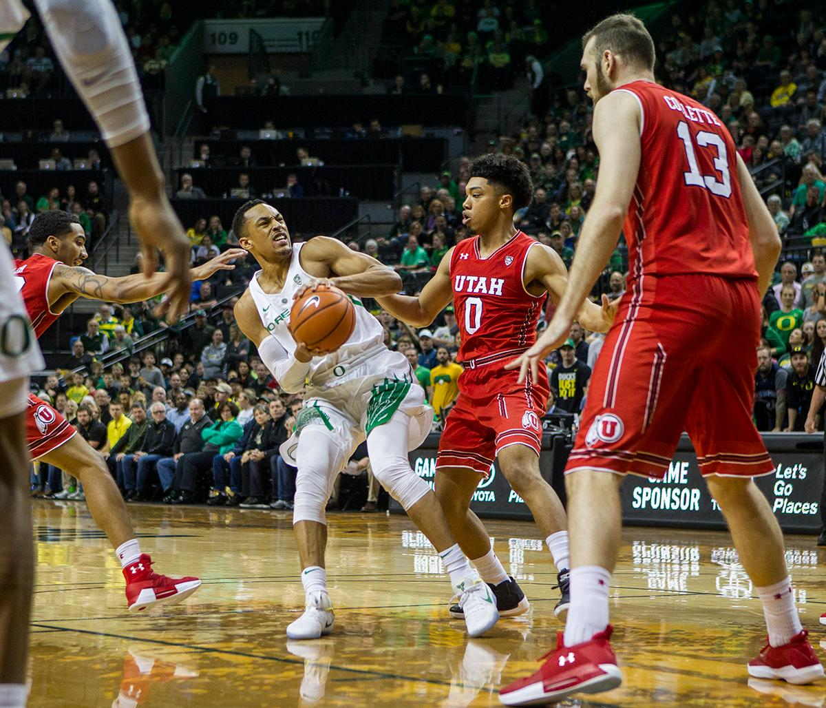 Oregon Ducks Elijah Brown (#5) attempts to keep control of the ball as he looks for the basket. The Utah Utes defeated the Oregon Ducks 66-56 on Friday night at Matthew Knight Arena. This is the first Pac-12 conference game loss at home for the Ducks since January of 2015. This also ended the five home game winning streak for the Ducks against the Utah Utes. Photo by Rhianna Gelhart, Oregon News Lab
