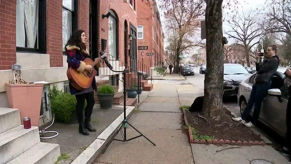 'Sidewalk serenades' spread happiness during coronavirus in Baltimore