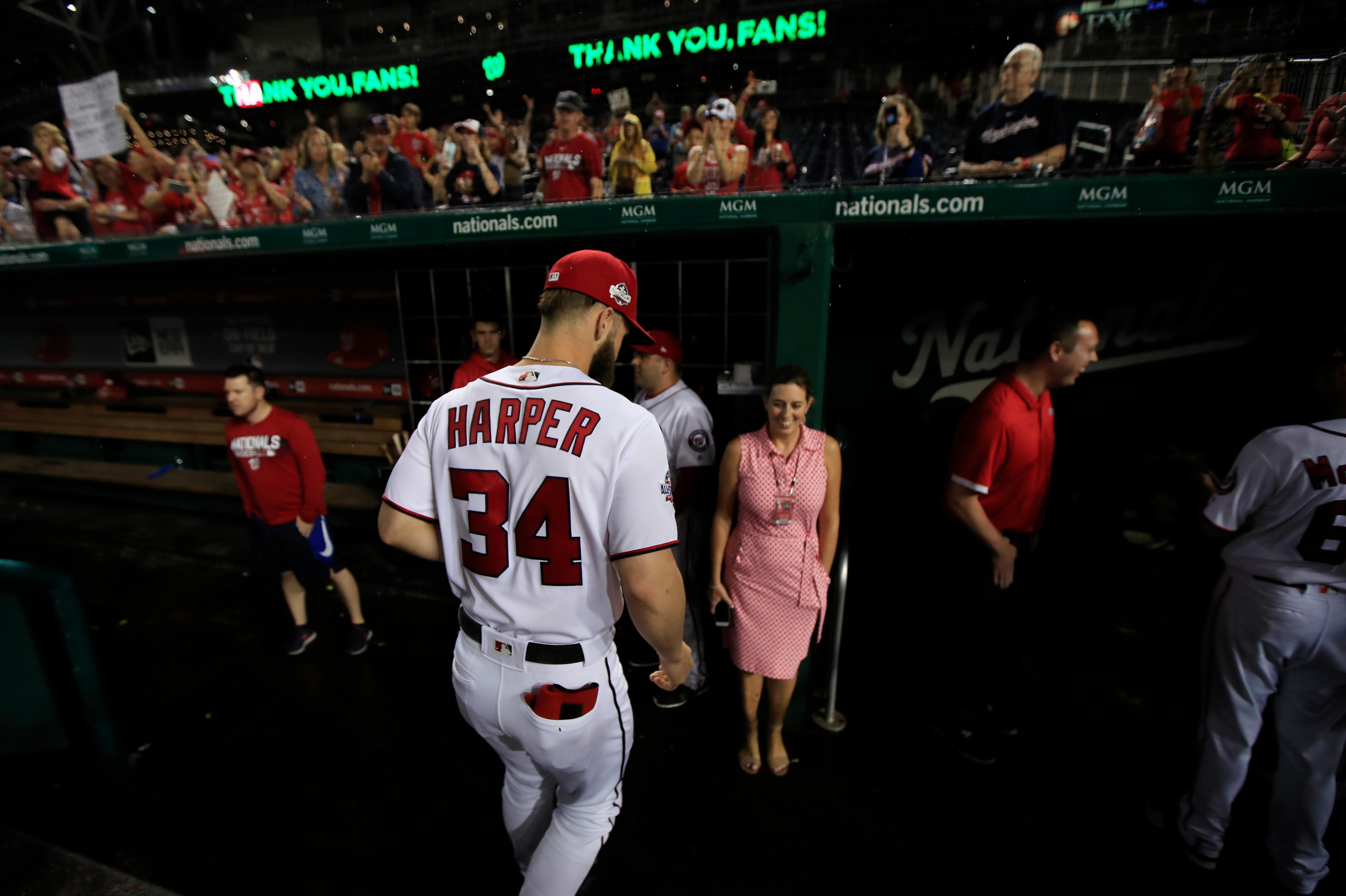 Washington Nationals Bryce Harper (34) leaves the field as the Nationals ended their last home game of the season with a 9-3 rain delayed win against the Miami Marlins in Washington, Wednesday, Sept. 26, 2018. (AP Photo/Manuel Balce Ceneta)
