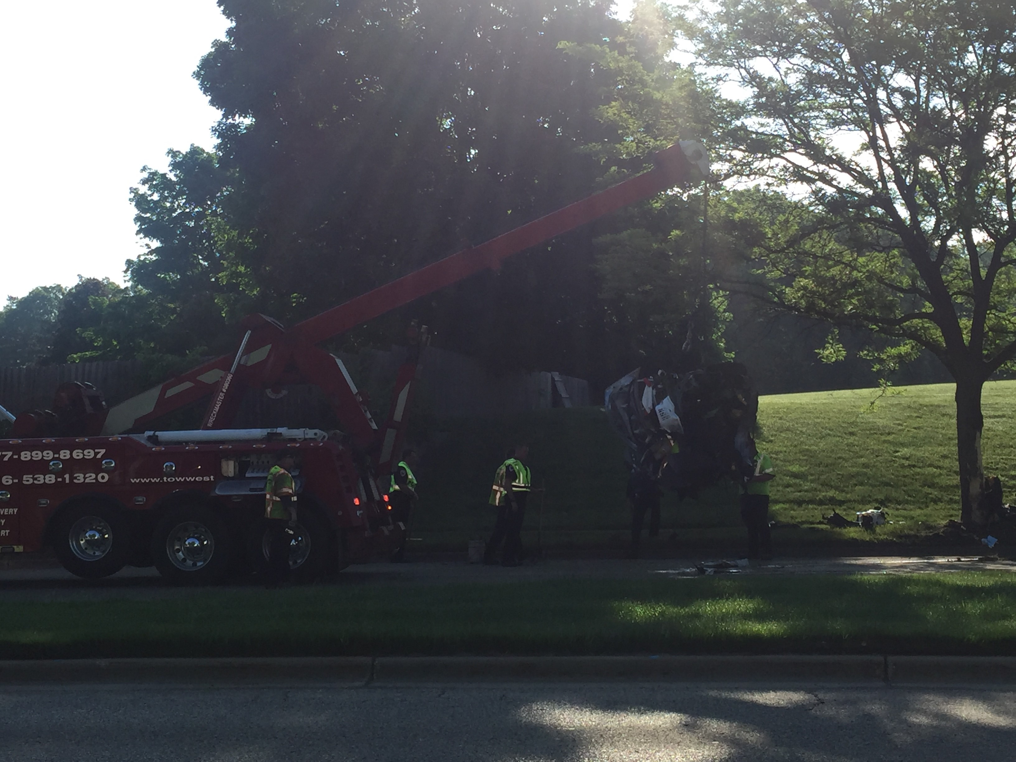 Crews work to clear a fatal crash into a tree in Wyoming Friday morning. (WWMT/Jessica Wheeler)