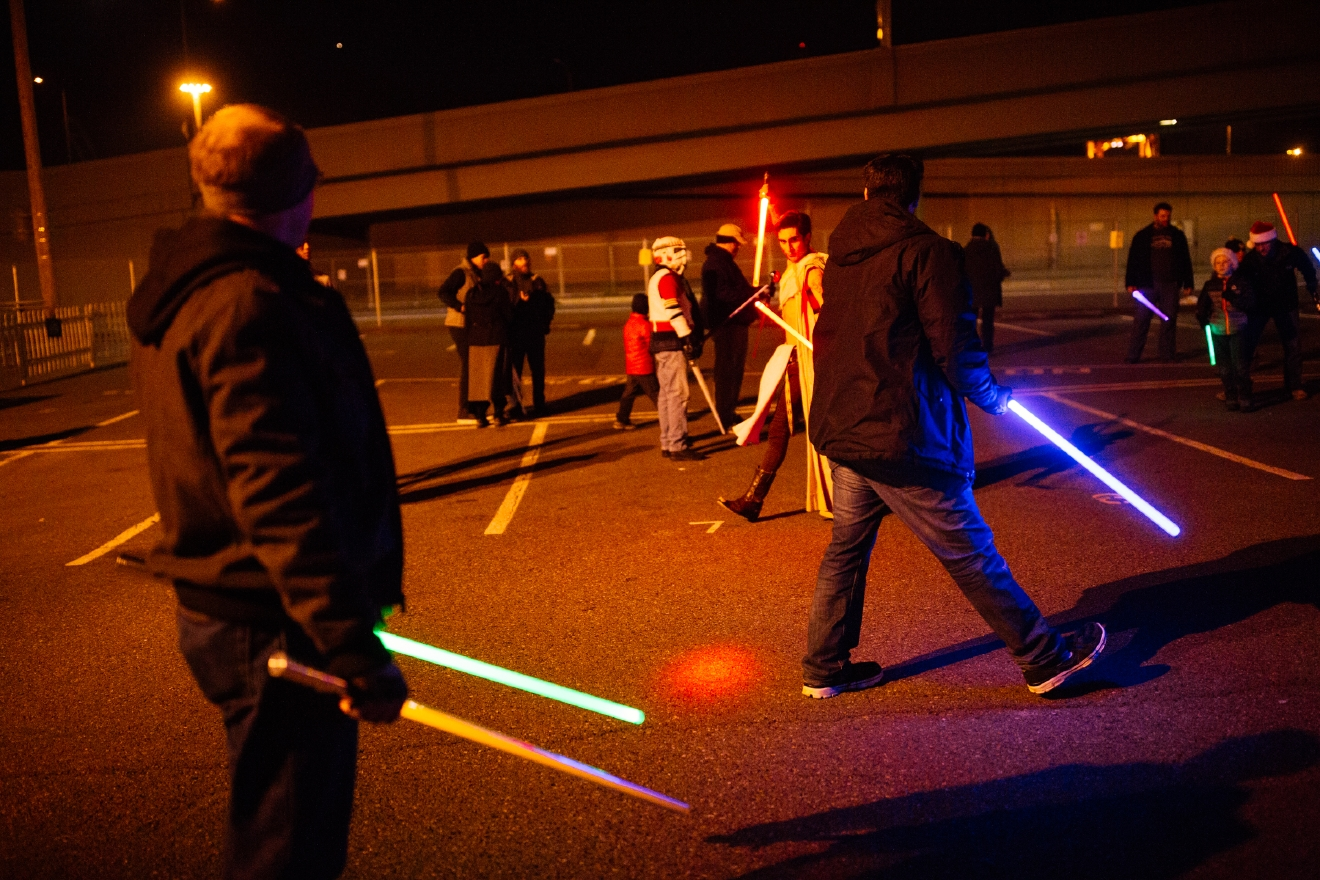 Newmindspace hosted a Glow Sword Battle in Seattle where Star Wars fans came out to duel at the Pyramid Tap House in Seattle, WA. This event followed up last years battle where thousands came out under the Space Needle. (Image: Joshua Lewis / Seattle Refined)