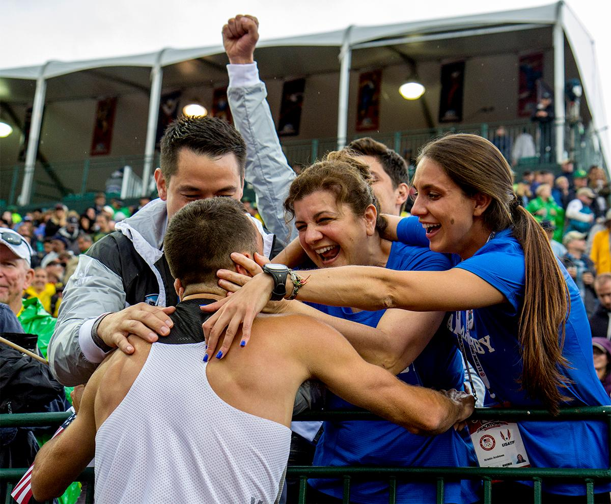 Adidas Robby Andrews greets his family after finishing second in the 1,500 meter final and qualifying for Rio. Photo by August Frank, Oregon News Lab