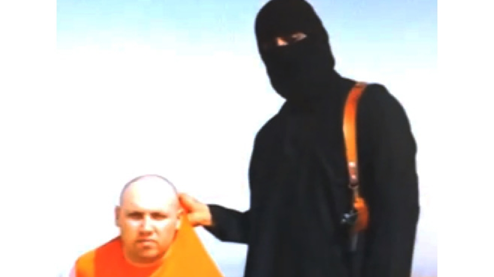 In this file still image from an undated video released by Islamic State militants on Tuesday, Aug. 19, 2014, purports to show journalist Steven Sotloff being held by the militant group. Islamic State militants called American journalist James Foley's gruesome videotaped beheading revenge for U.S. airstrikes against the group, and they still hold at least three other Americans hostage, including Sotloff. (AP Photo, File)