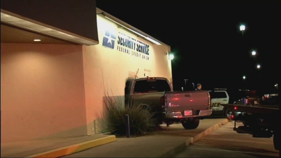 Driver crashes into bank building after pulling out of Whataburger