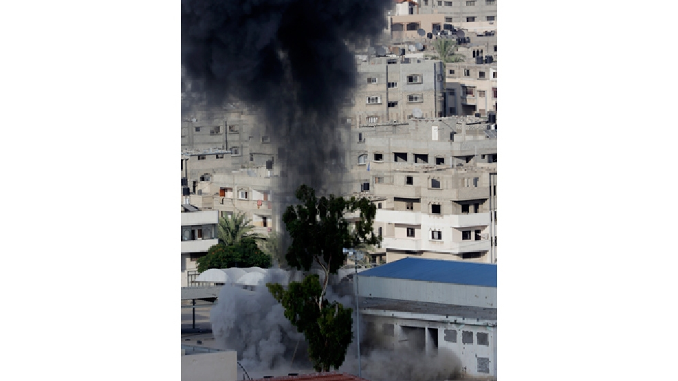 Smoke rises after an Israeli missile strike in Gaza City, in the northern Gaza Strip, Sunday, July 20, 2014. A Gaza City neighborhood came under heavy tank fire Sunday as Israel widened its ground offensive against Hamas, causing hundreds of panicked residents to flee. (AP Photo/Adel Hana)