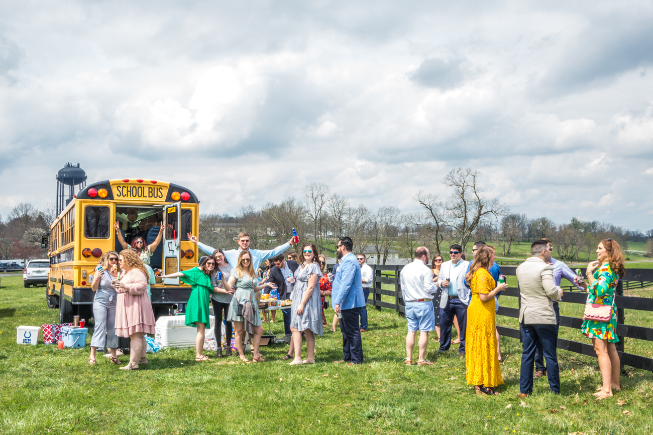 A group of Keeneland attendees tailgate on the hill outside the racetrack / Image courtesy of Catherine Viox // Published:{ }4.12.19