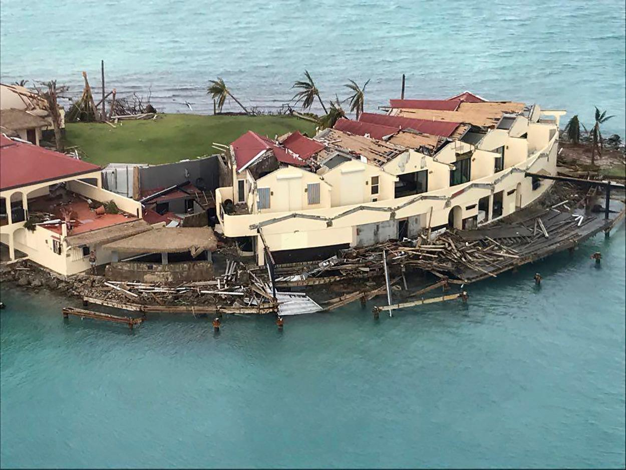 This photo provided on Friday, Sept. 8, 2017, shows storm damage in the aftermath of Hurricane Irma in Virgin Gorda's Saba Rock in the British Virgin Islands. Irma scraped Cuba's northern coast Friday on a course toward Florida, leaving in its wake a ravaged string of Caribbean resort islands strewn with splintered lumber, corrugated metal and broken concrete. (Caribbean Buzz Helicopters via AP)
