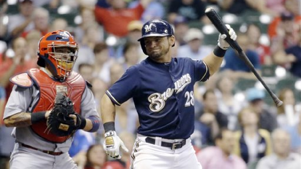 St. Louis Cardinals catcher Yadier Molina watches as Milwaukee Brewers' Gerardo Parra reacts after Parra struck out during the ninth inning of a baseball game Thursday, Sept. 4, 2014, in Milwaukee. The Cardinals won 3-2. (AP Photo/Morry Gash)