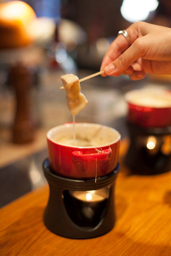 Right Proper Brewing Co. in Shaw offers a classic Swiss-style fondue each Tuesday from 5–11 p.m. using the cheesemonger's cheese selection, which might be a blend or one specific cheese like the Jumi Raclette, a raw cow's milk cheese from Switzerland. Kirsch, house-brewed beer and garlic are added to the mix and served in an adorable Le Creuset pot with baguette.{ }(Image: Leah Cheston){ }