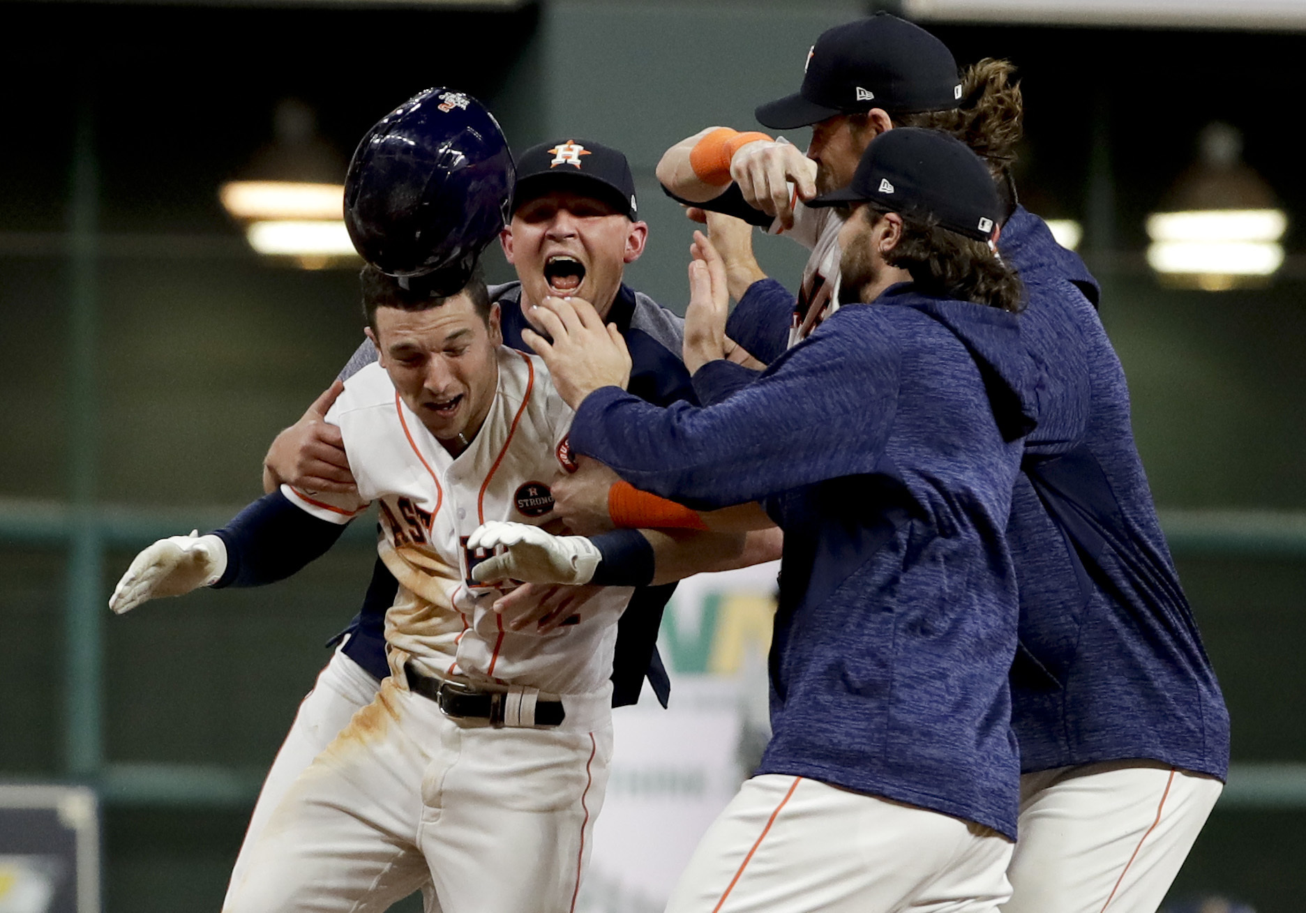 The Houston Astros celebrates after Alex Bregman (2) game winning single during Game 5 of baseball's World Series against the Los Angeles Dodgers Monday, Oct. 30, 2017, in Houston. Astros won 13-12. (AP Photo/Matt Slocum)