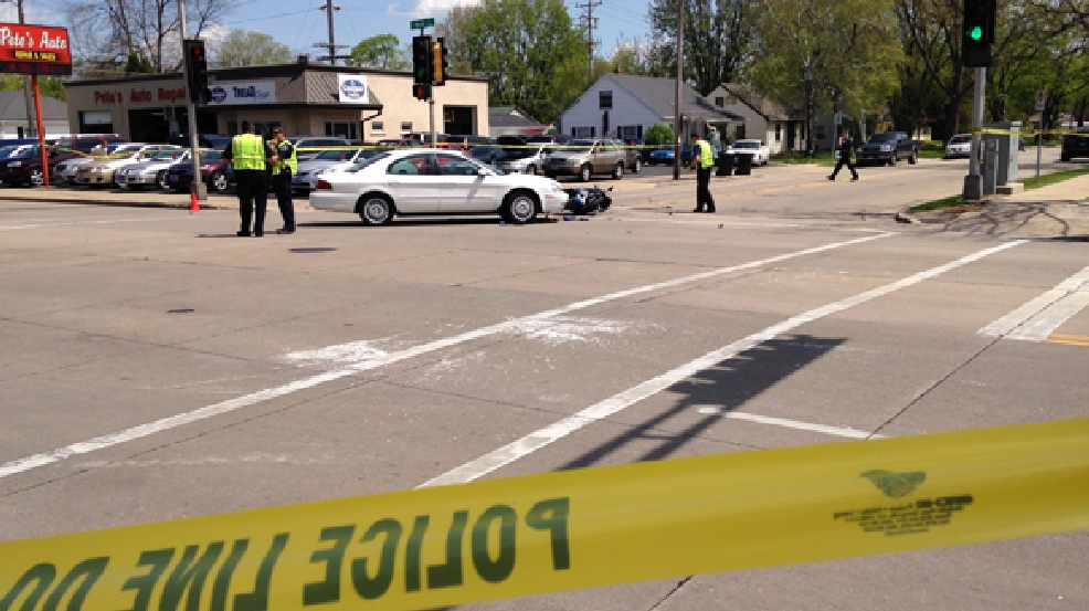 Appleton police officers on the scene of a car and motorcycle crash at the intersection of E. Glendale Ave. and N. Meade St. on Wednesday, May 21, 2014. (WLUK/Chris Bourassa)