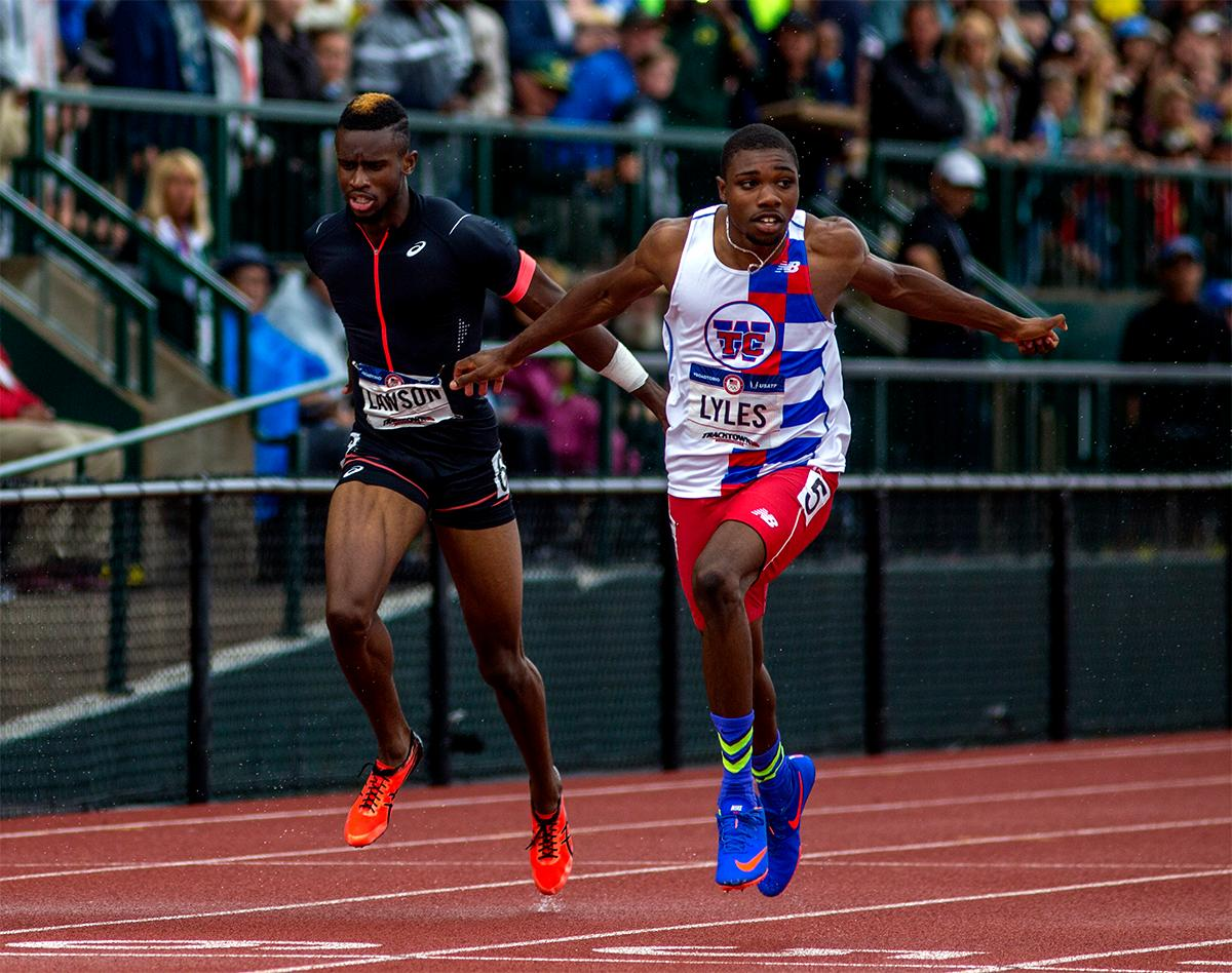 Noah Lyles (right) and Jarrion Lawson hit the line in the 200 meter semi-finals. Lyles won his heat with a time of 20.26. Photo by August Frank, Oregon News Lab