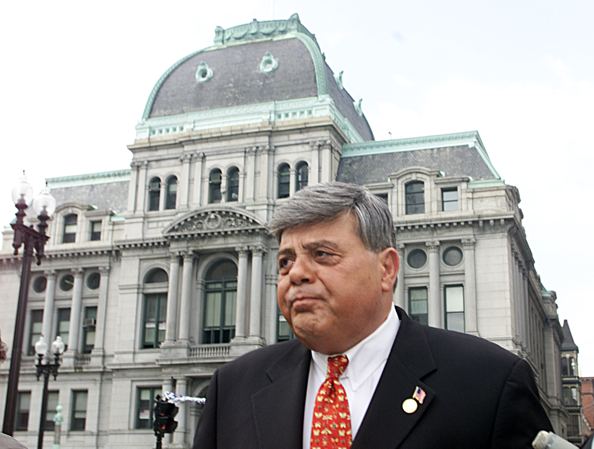 Providence Mayor Vincent Cianci Jr., walks from his residence at the Biltmore Hotel to the Federal Court House passing in front of City Hall Wednesday, April 17, 2002 in Providence, R.I. The mayor and five others were indicted last April on charges that include racketeering, bribery and extortion. Jury selection in the case against Cianci and three others begins Wednesday. The 60-year-old Cianci is the longest-serving big city mayor in America and among the most popular political figures in state history. (AP Photo/Stew Milne)