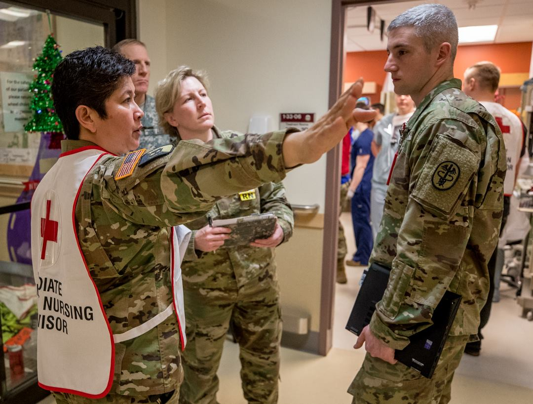 Medical Personnel treat victims from the Amtrak train derailment at Madigan Army Medical Center (Photo: U.S. Army)