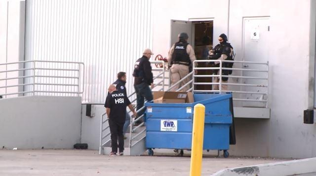 Agents enter a building in San Diego. Inside the building is a tunnel to Tijuana where officials say tons of marijuana and cocaine were being illegally brought into the country.