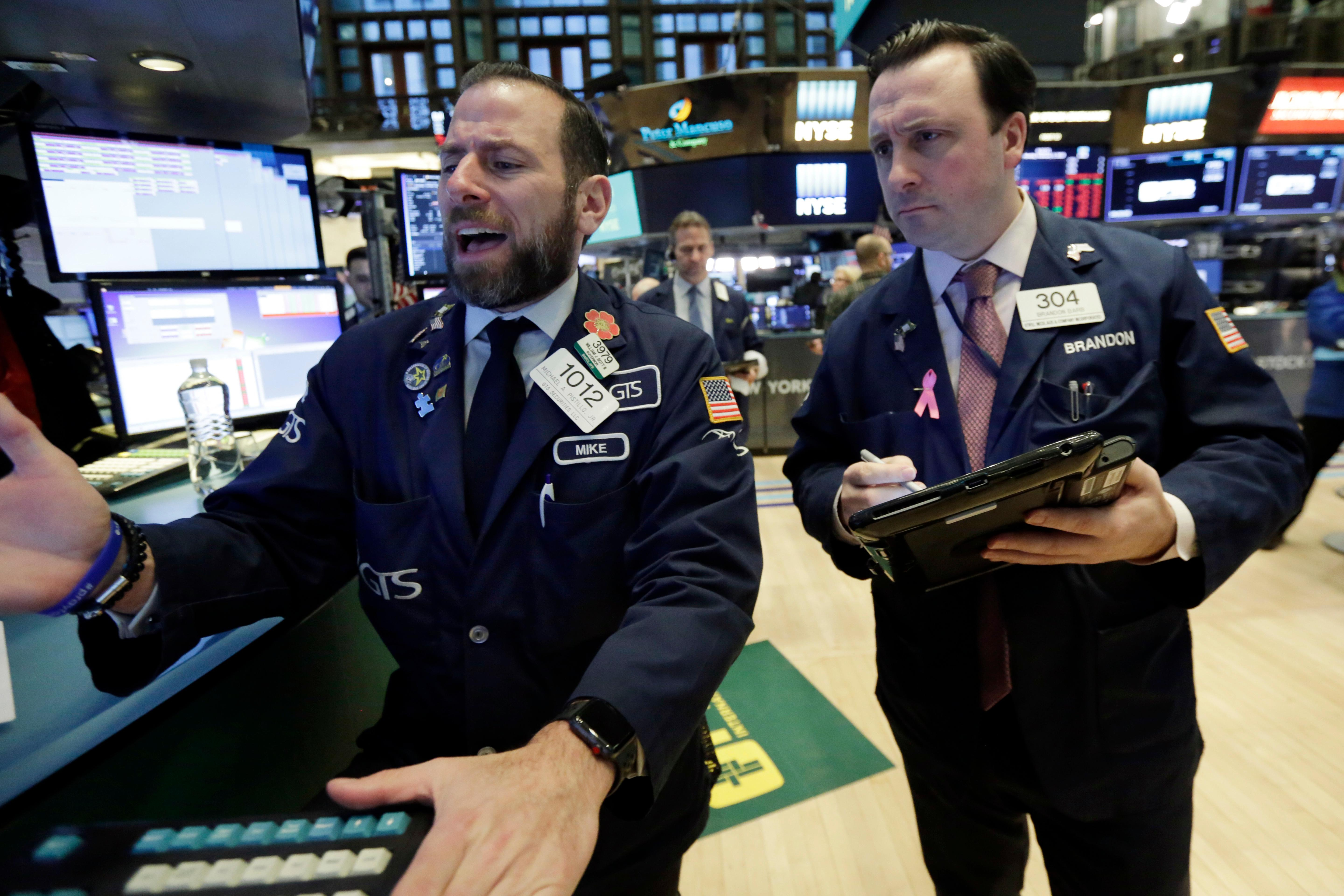 Specialist Michael Pistillo, left, and trader Brandon Barb work on the floor of the New York Stock Exchange, Monday, Feb. 5, 2018. Stock markets around the world took another pummeling Monday as investors continued to fret over rising U.S. bond yields. (AP Photo/Richard Drew)