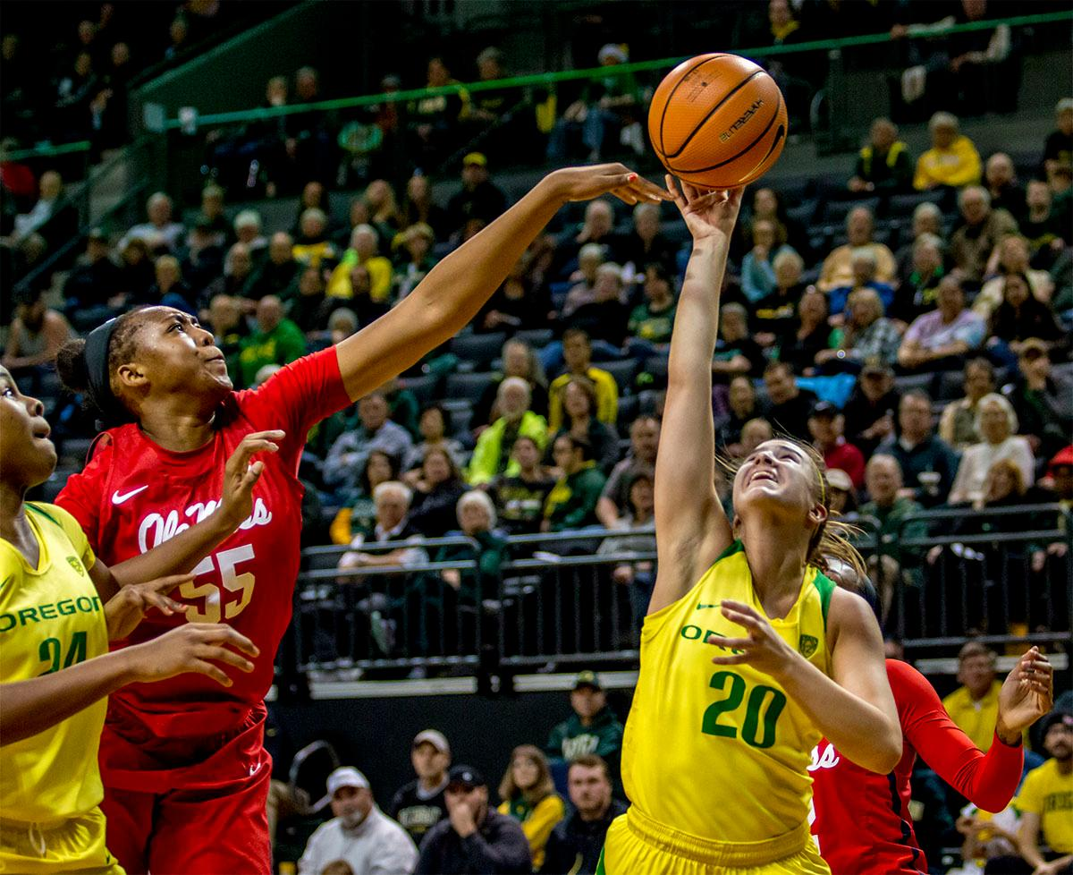 The Rebel's Promise Taylor (#55) blocks the Sabrina Ionescu's shot. The Duck's Sabrina Ionescu (#20) is introduced at the start of the game against the Ole Miss Rebels. The Oregon Ducks womens basketball team defeated the Ole Miss Rebels 90-46 on Sunday at Matthew Knight Arena. Sabrina Ionescu tied the NCAA record for triple-doubles, finishing the game with 21 points, 14 assists, and 11 rebounds. Ruthy Hebard added 16 points, Satou Sabally added 12, and both Lexi Bando and Maite Cazorla scored 10 each. The Ducks will next face off against Texas A&M on Thursday Dec. 21 and Hawaii on Friday Dec. 22 in Las Vegas for Duel in the Desert before the start of Pac-12 games. Photo by August Frank, Oregon News Lab