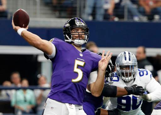 Baltimore Ravens quarterback Joe Flacco (5) throws a pass under pressure from Dallas Cowboys' Demarcus Lawrence (90) in the first half of an NFL football game, Sunday, Nov. 20, 2016, in Arlington, Texas. (AP Photo/Michael Ainsworth)