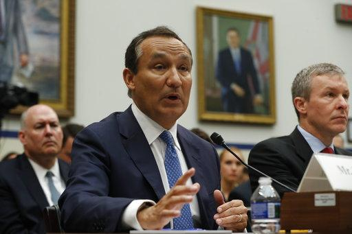 United Airlines CEO Oscar Munoz, left, accompanied by United Airlines President Scott Kirby, testifies on Capitol Hill in Washington, Tuesday, May 2, 2017, before a House Transportation Committee oversight hearing. (AP Photo/Pablo Martinez Monsivais)