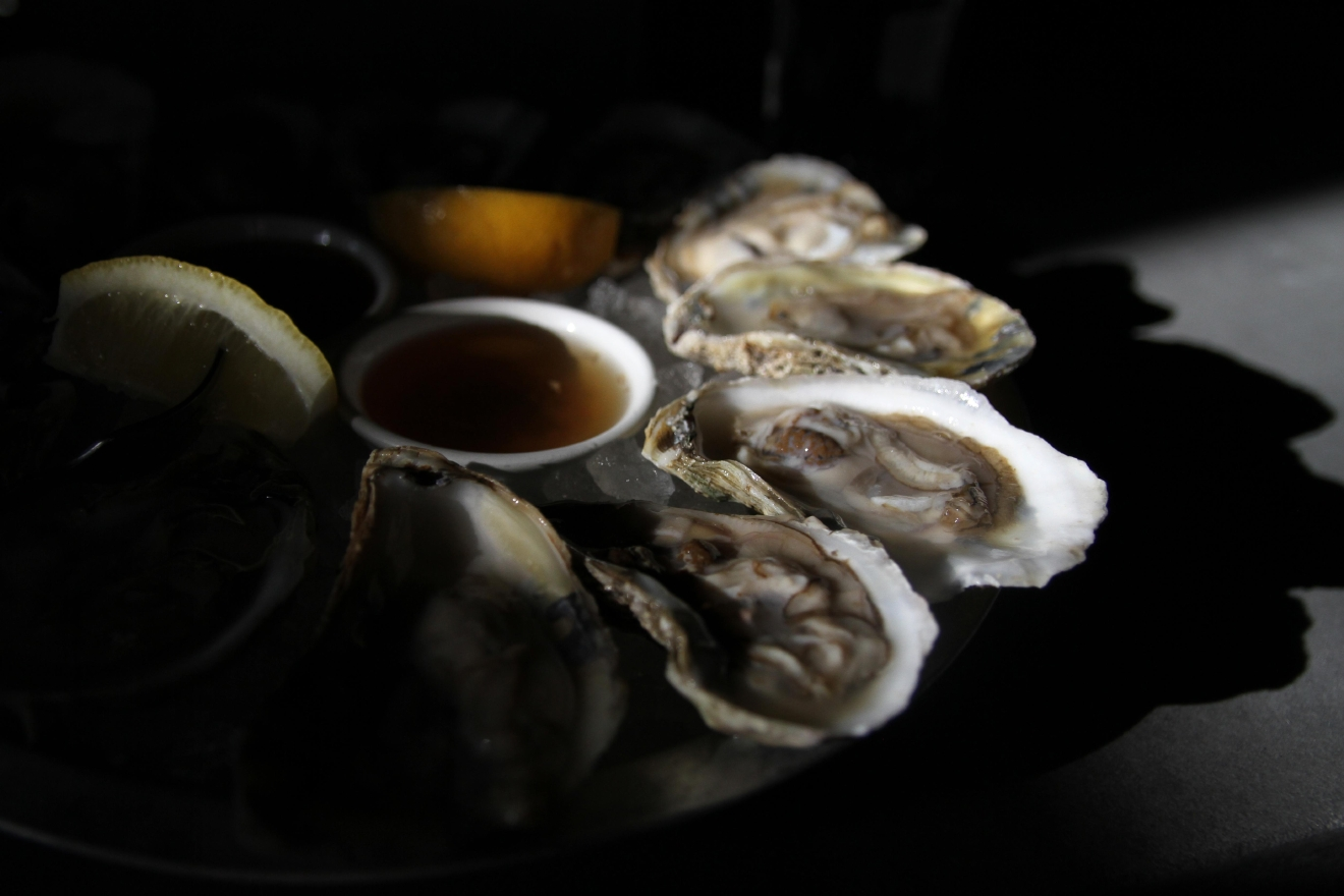 Oysters are an aphrodisiac, but if you're eating alone then you're not going to kiss anyone with that breath anyways. Still, Eat The Rich's bar setting makes it easier to slurp down an order of oysters by yourself. (Amanda Andrade-Rhoades/DC Refined)