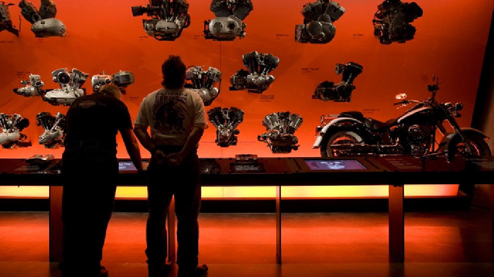 Shawn McCauley, left, and Bill Halling both of Des Moines, Iowa, look at a display during a preview of the Harley-Davidson museum Monday, July 7, 2008, in Milwaukee. (AP Photo/Morry Gash)