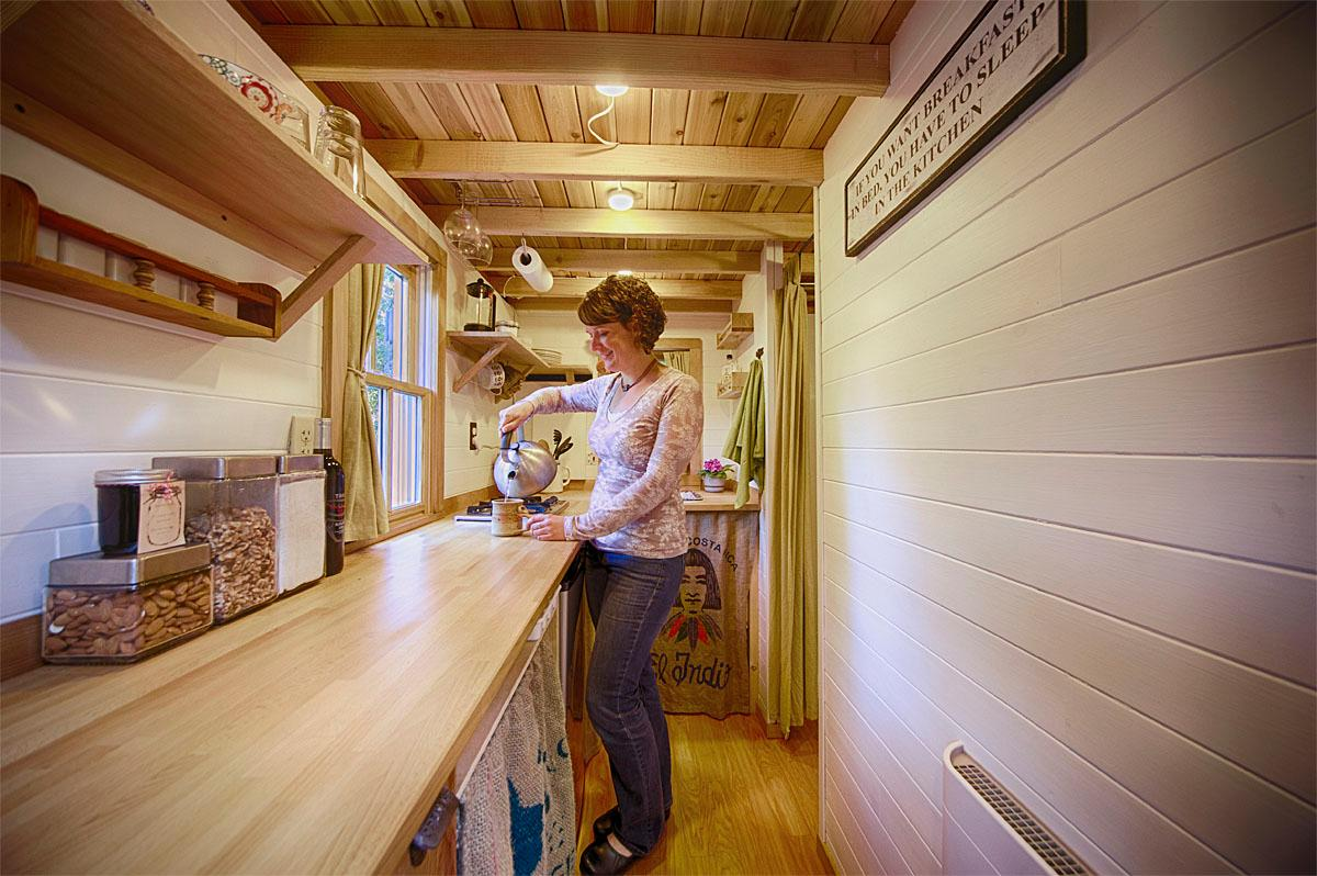 Brittany Yunker in the kitchen of The Bayside Bungalow in Olympia, WA. (Photo by Christopher Tack, courtesy of the Tumbleweed Tiny House Company)