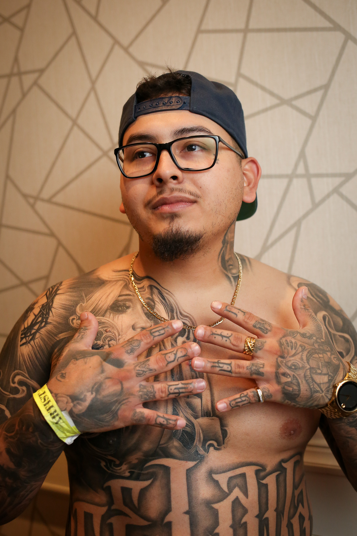 Mitchell Celaya of Under The Gun tattoo. (Amanda Andrade-Rhoades/DC Refined) <p></p>