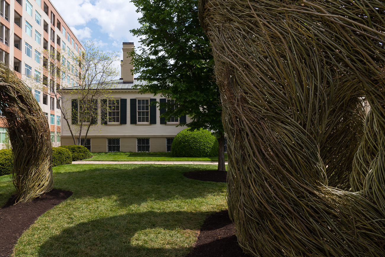 "On the front lawn of the Taft Museum of Art, six tons of willow tree saplings have been molded into a massive outdoor sculpture. The piece is titled ""Far Flung"" and is the vision of world-famous artist Patrick Dougherty. The installation, exhibited as Twisted: Patrick Dougherty Entwined at the Taft, is free to examine up close during normal museum hours and will remain on the grounds anywhere from 18 months to two years. / Image: Phil Armstrong, Cincinnati Refined // Published: 5.3.18"
