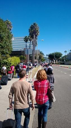 Crowds form outside Los Angeles International Airport as flights were delayed following a shooting Friday.