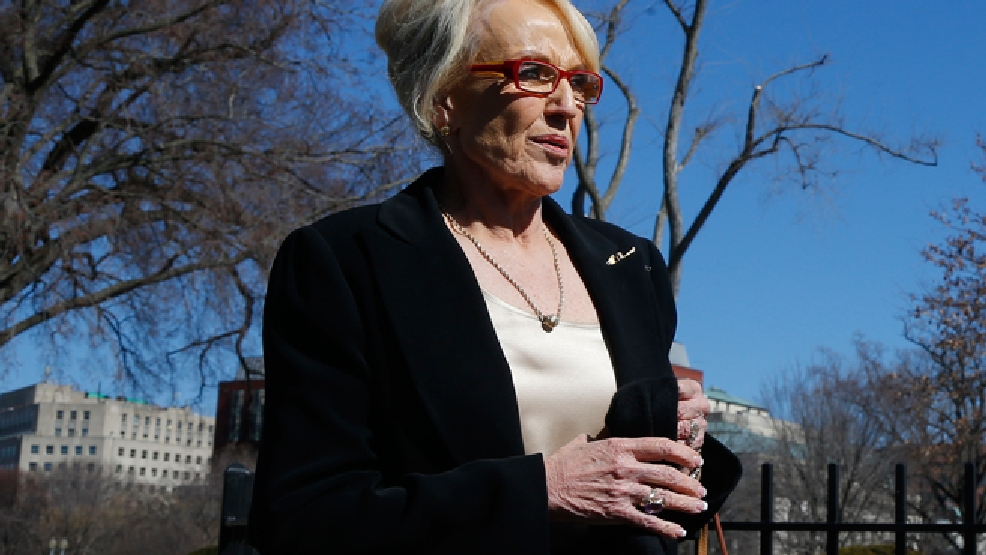 Arizona Gov. Jan Brewer walks towards the West Wing of the White House in Washington, Monday, Feb. 24, 2014, after the National Governors Association met with President Barack Obama. (AP Photo/Charles Dharapak)