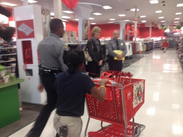 Officers from OCPD, Target team members and children hit the aisles to get some things on their lists this year.