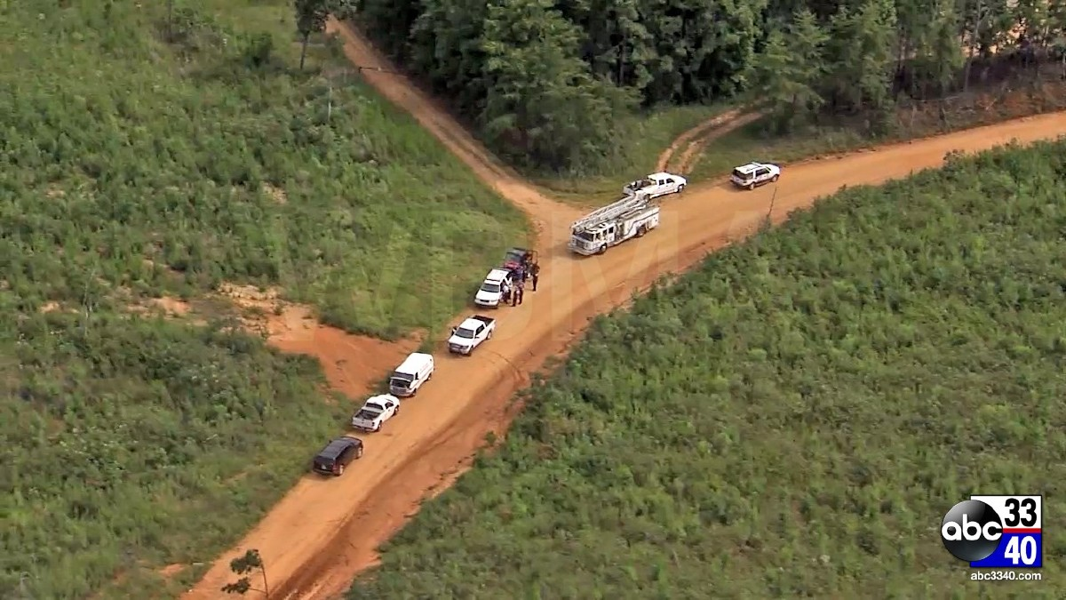 Authorities on the scene of a helicopter crash in Tuscaloosa County, Alabama that left killed two people, Tuesday, August 19, 2014.