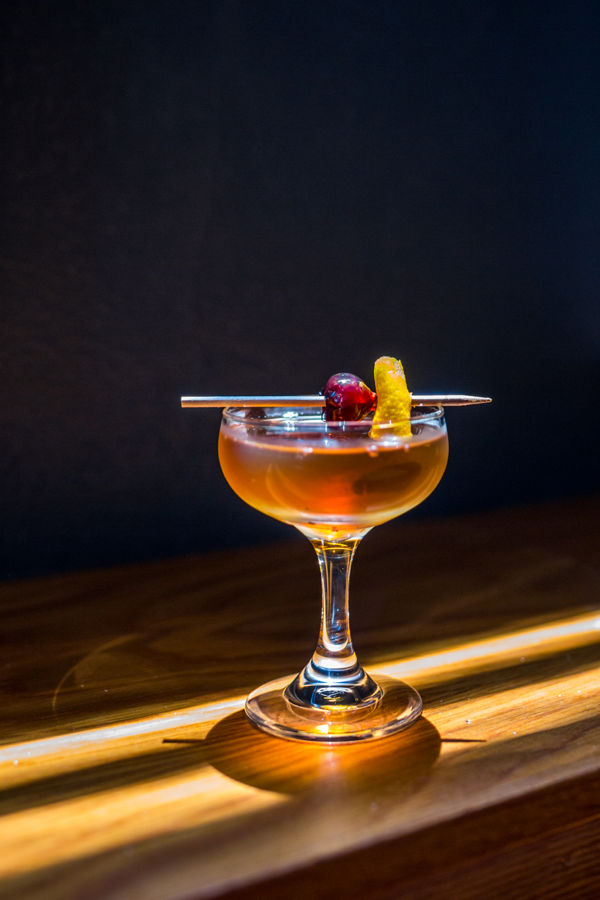 Nero Manhattan: rye whiskey, Amaro liqueor, orange, and black walnut / Image: Catherine Viox // Published: 7.12.19