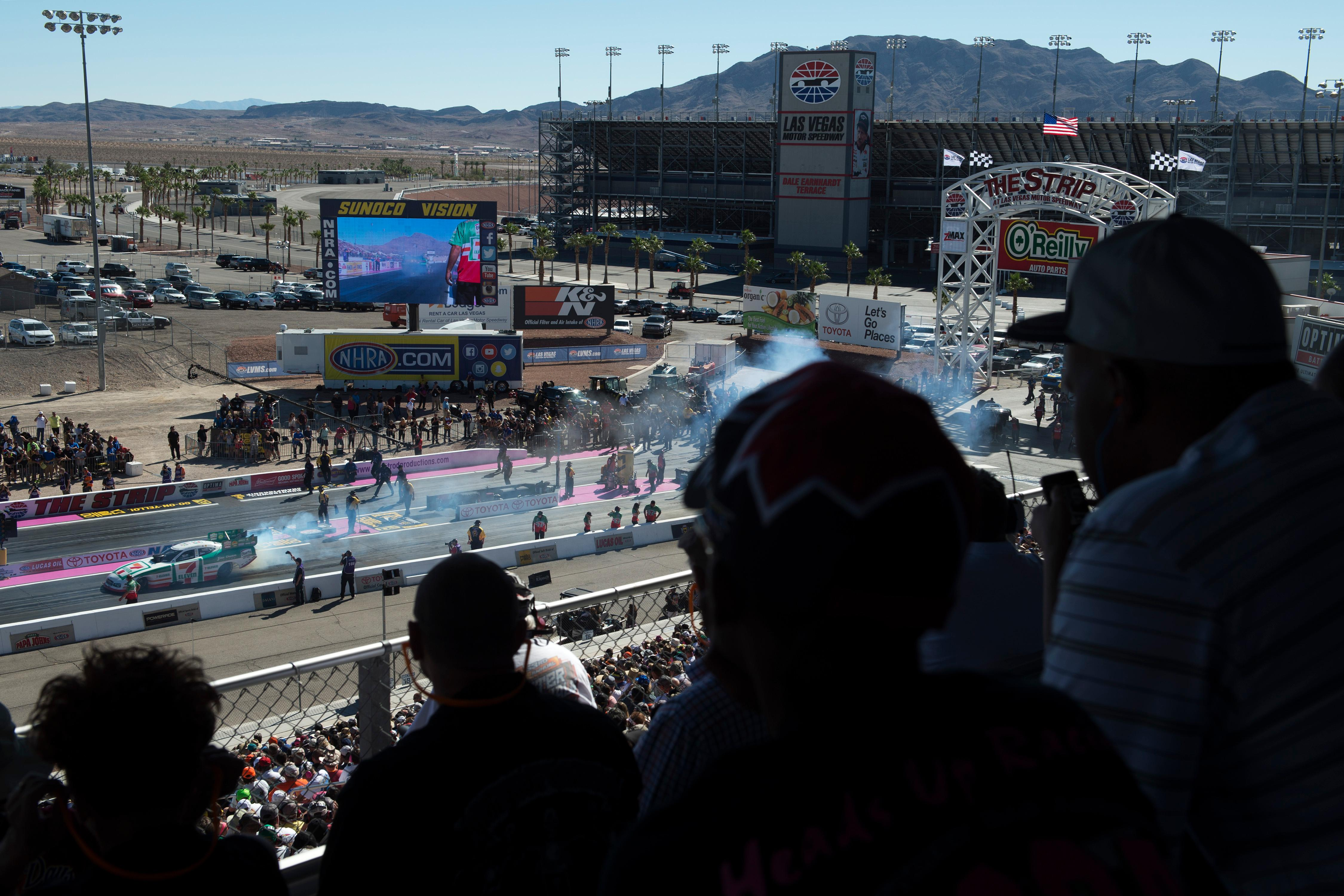Fans watch Funny Car driver Jim Campbell smoke his tires before a run during the NHRA Toyota Nationals Sunday, October 29, 2017, at The Strip at the Las Vegas Motor Speedway. CREDIT: Sam Morris/Las Vegas News Bureau