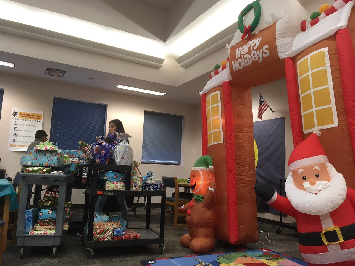 Khalid's mother, Linda Wolfe, and his sister handed out gifts to some students at Ernesto Serna School in Socorro on Tuesday, Dec. 13, 2017. (Credit: KFOX14/CBS4)