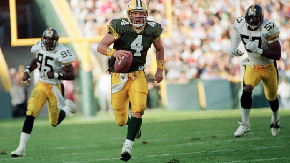 Green Bay Packers quarterback Brett Favre (4) runs for a first down while being chased by Pittsburgh Steelers linebacker Greg Lloyd (95) in the third quarter of their game in Green Bay on Sept. 27, 1992. The Packers went on to win the game 17-3. (AP Photo/Chris Corsmeier)