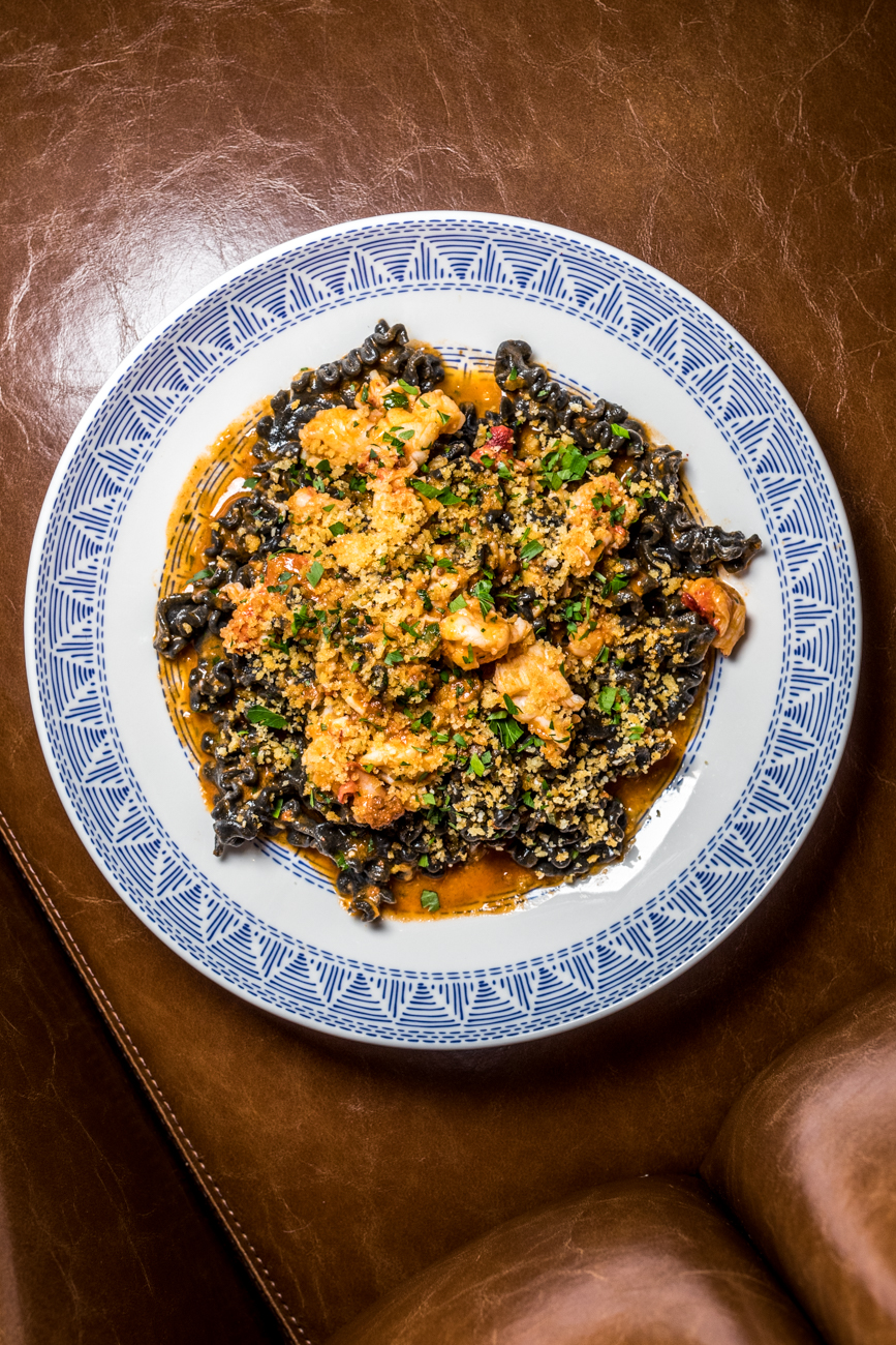 Lobster Pasta: squid ink fusilli pasta, lobster, La Quercia nduja, lobster broth, and garlic breadcrumbs paired with the house white wine / Image: Catherine Viox // Published: 2.11.20