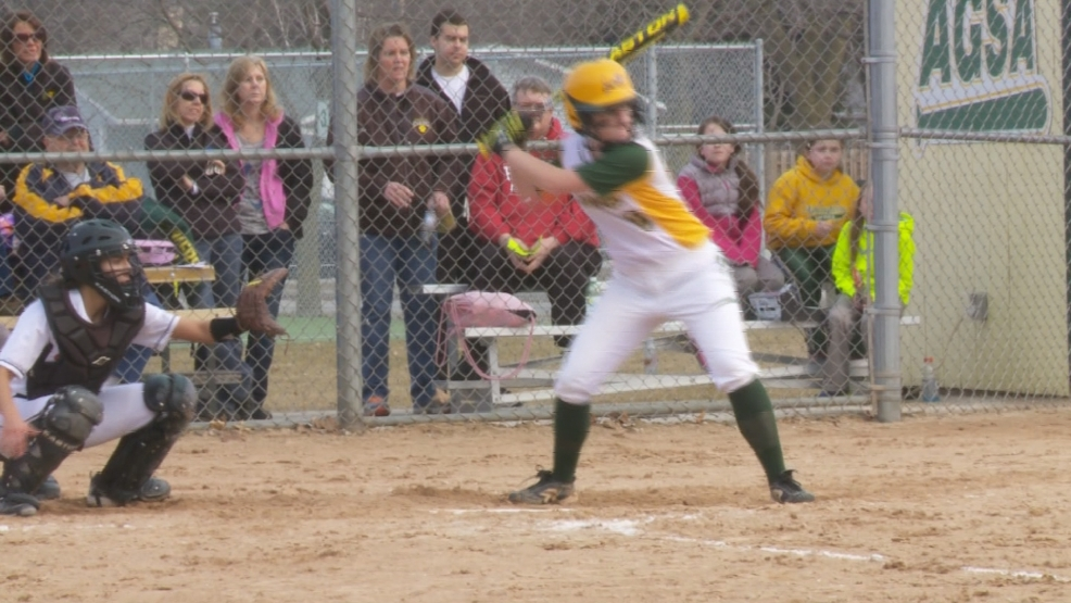 Ashwaubenon softball player Madison Manders hits during a game on Monday, April 7, 2014.