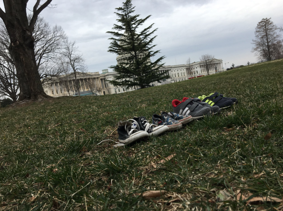 Approximately 7,000 pairs of shoes were displayed on the lawn outside the U.S. Capitol Tuesday to represent the number of children killed in U.S. shootings since the 2012 mass shooting at Sandy Hook Elementary School in Newtown, Connecticut. (WJLA/Ryan Hughes)