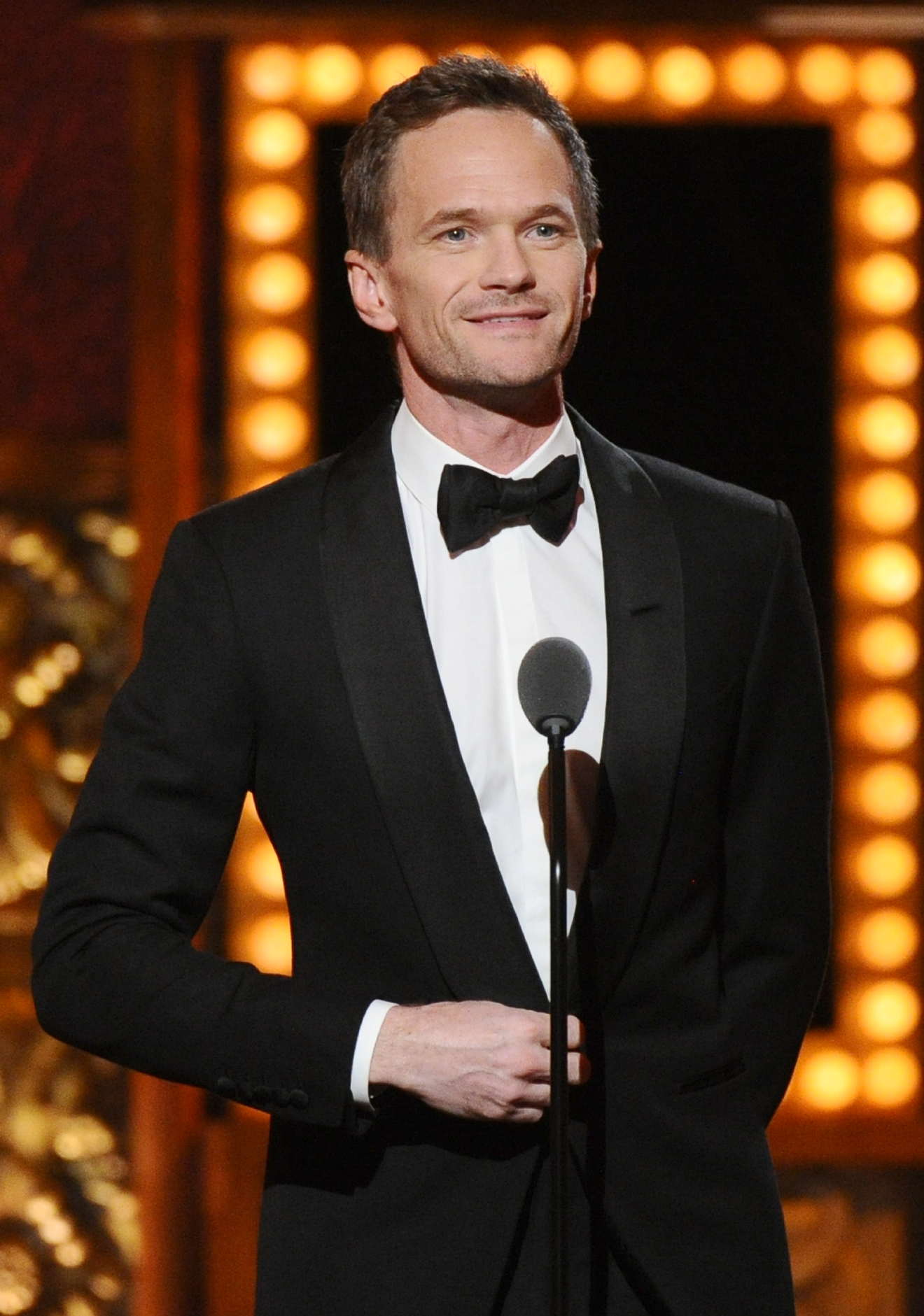 FILE - In this June 7, 2015 file photo, Neil Patrick Harris presents an award at the 69th annual Tony Awards in New York. Harris will serve as a presenter for this year's Tony Awards, help Sunday, June 12, at the Beacon Theatre in New York. (Photo by Charles Sykes/Invision/AP, File)