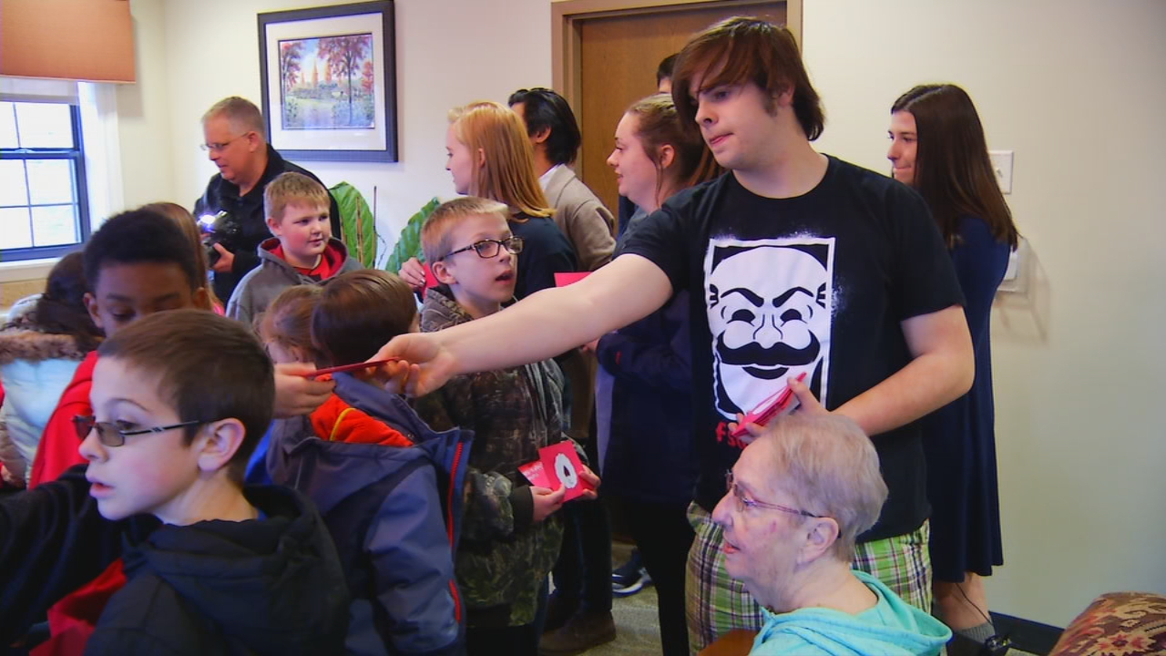 Students from West Henderson High School teamed up with students from Glenn C. Marlow Elementary to visit with residents at The Lodge at Mills River. (Photo credit: WLOS Staff)