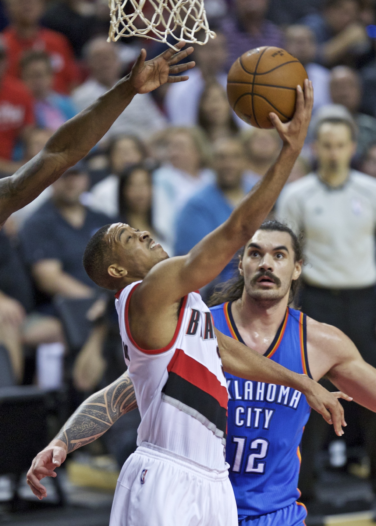 Portland Trail Blazers guard C.J. McCollum shoots in front of Oklahoma City Thunder center Steven Adams during the second half of an NBA basketball game in Portland, Ore., Wednesday, April 6, 2016. (AP Photo/Craig Mitchelldyer)