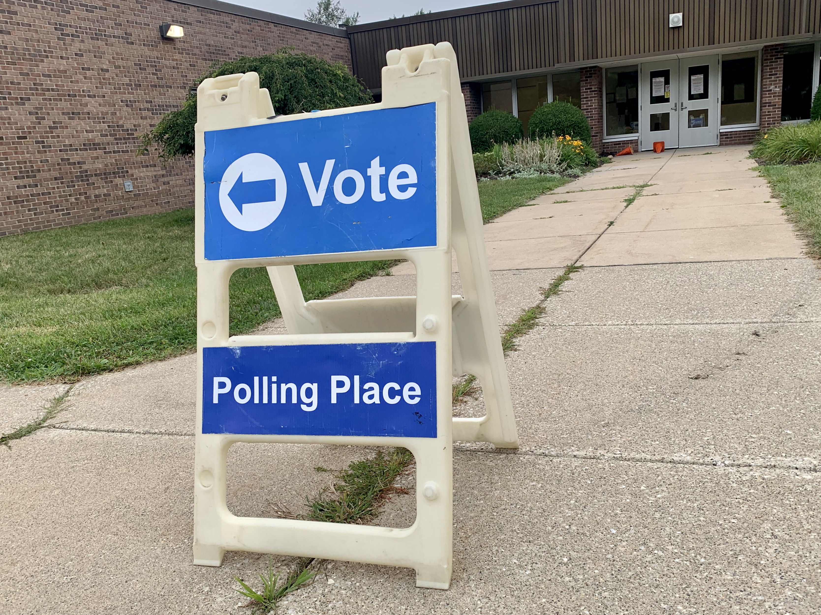 Polling places, with reminders to maintain social distancing because of the COVID-19 pandemic, opened across Michigan at 7 a.m. Tuesday for the state's primary election. (WWMT/Hannah Knowles)