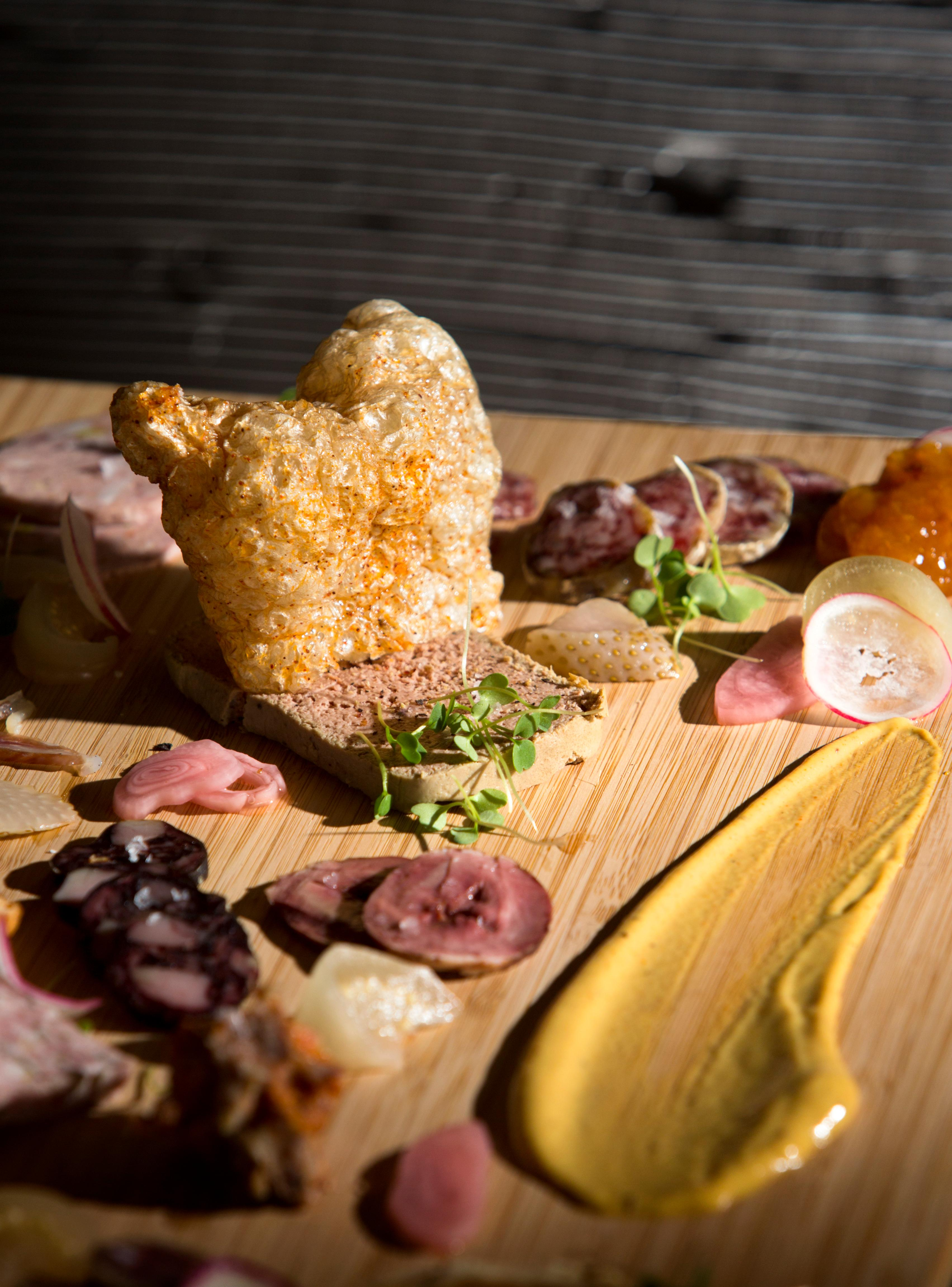 Everything is prepared in-house on the LPC Charcuterie Plate. Owner and chef Derek Ronspies whips up a new menu everyday at his restaurant, Le Petit Cochon. (Sy Bean / Seattle Refined)